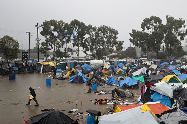 Torrential downpour devastates migrants waiting in Tijuana