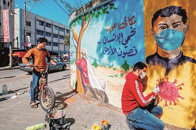 Art imitates life? Street artists paint walls with colorful coronavirus themes across the world