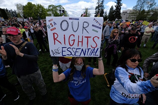 People demonstrate outside Washington State Capitol