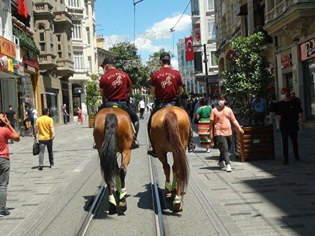 Turkish policemen patrol iconic Taksim square on horseback
