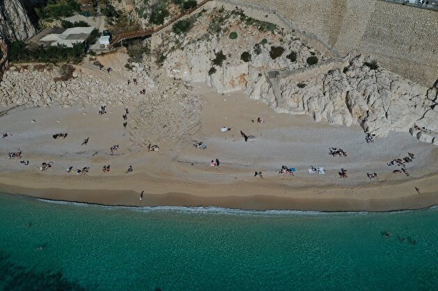 Tourists flock to deserted beaches while locals confine at home in Turkey's Antalya