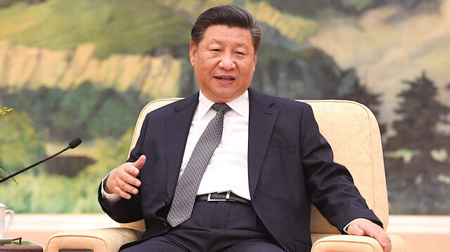 China's Xi says Japan relations back on 'right track'
