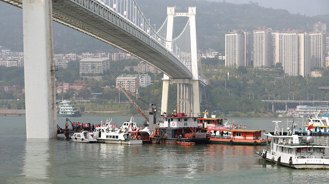 Two dead after China bus plunges 60 metres into river