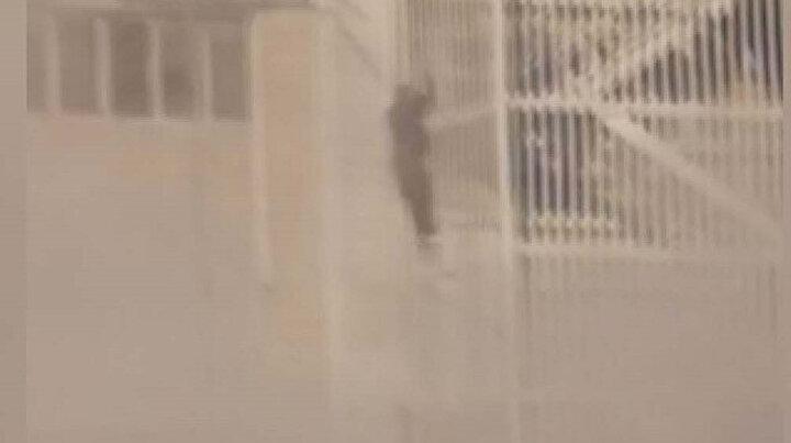 Alevlerin arasında kalan adamın ölümden anbean kaçışı