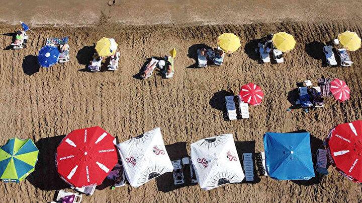 Çinliler bile geliyor: Hava sıcaklığı 33 dereceyi buldu, tatilciler Kızkalesi'ne akın etti