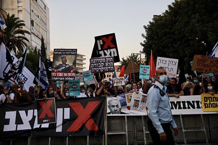 Kovid-19 salgınında ikinci dalganın etkisine giren ve işsizliğin yüzde 21'e çıktığı İsrail'de Başbakan Netanyahu karşıtı gösteriler artarak devam ediyor.
