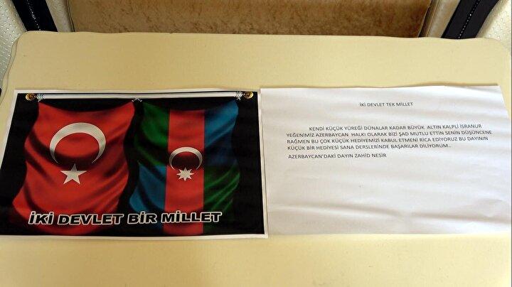 Tablet almak için biriktirdiği kumbarasındaki bütün parasını Azerbaycan silahlı kuvvetlerine bağışlayan İsranur, mektubun üstüne kalp çizip, üzerine Türkiye ve Azerbaycan yazarak, bir zarfın içinde posta yoluyla İlham Aliyeve gönderdi.