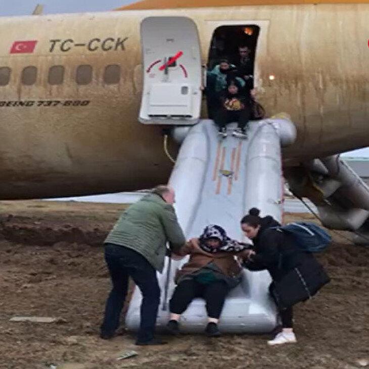 Pistten çıkan uçaktan şişme yastık ve kaydırakla kurtuldular