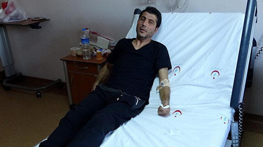 Sağlık ekipleri Cihani Rıza Üzülmez'i ambulanstan indirdi.