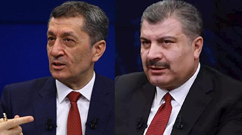 Milli Eğitim Bakanı Ziya Selçuk (solda) ve Sağlık Bakanı Fahrettin Koca (sağda).