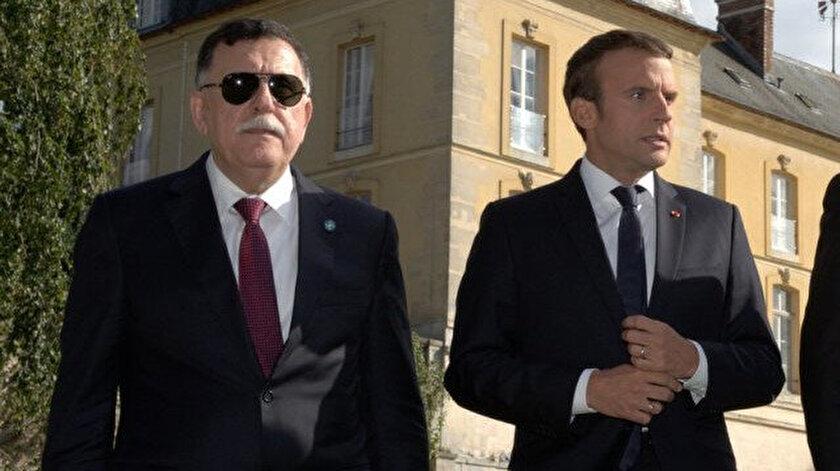 UMH Başbakanı Serrac (solda) ve Fransa Cumhurbaşkanı Macron (ortada).