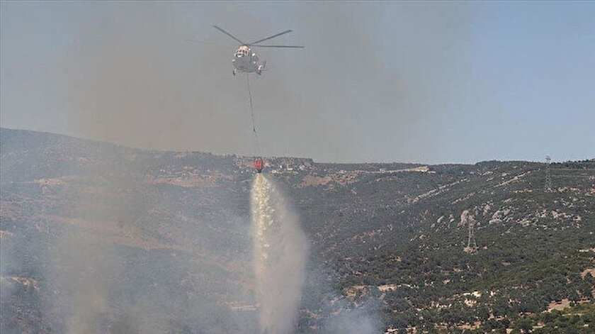 Yangına havadan ve karadan müdahale edildi.