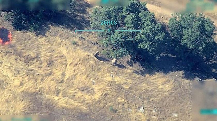 Saniye saniye kaydedilen görüntülerde iki teröristin ormanlık alanı ateşe vermesi, yangının ağaçlara sıçraması ve bölgede uzun süre yoğun duman yükselmesi yer alıyor.