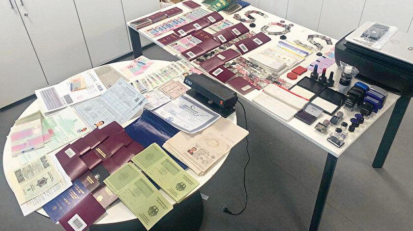 'Yasadışı Göç'e dur diyen ekipler havalimanında son 6 ayda 2 bin 400 adet sahte seyahat belgesi ele geçirdi.