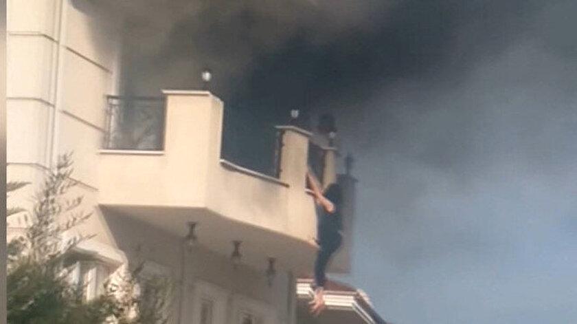 Villada dehşet anları: Alevlerden kaçmak için balkondan sarktı