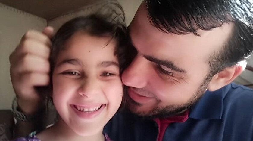 Hava saldırılarından korkan kızlarını teskin etmeye çalışan Gazzeli baba İsrailin saldırılarında şehit oldu