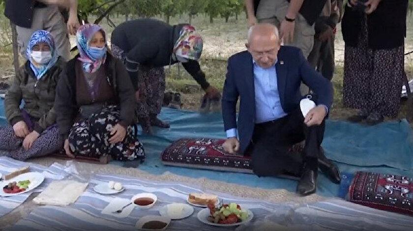 Kemal Kılıçdaroğlu yer sofrasına ayakkabılarını çıkarmadan oturdu