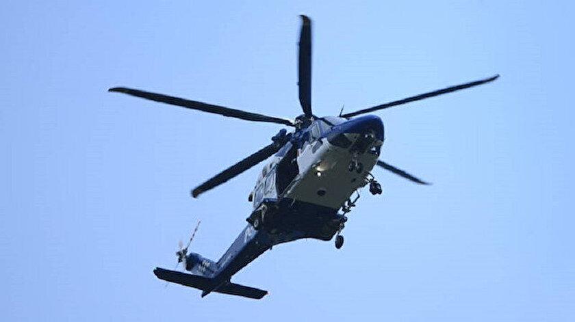 Yeni Zelandada bir firari teslim olmak için polis merkezine helikopterle gitti
