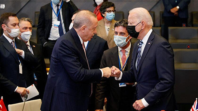 AFP ve Reuters Erdoğan ile Bidenin tokalaştığı anı çarpıtarak servis etti