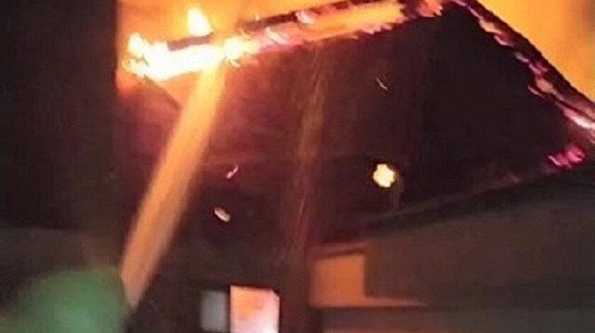 Amasyada karşı apartmandaki yangına balkondan hortumla müdahale etti