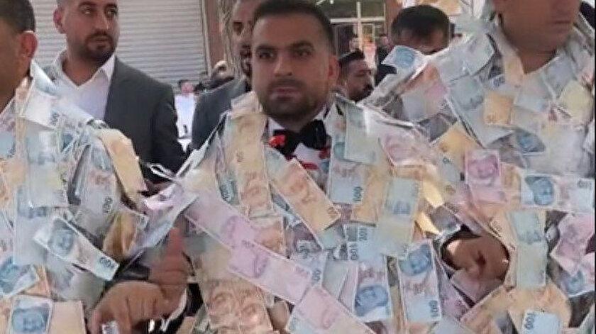 Damat paraların içinde kayboldu: Aşiret düğününden bu görüntüler sosyal medyaya damga vurdu