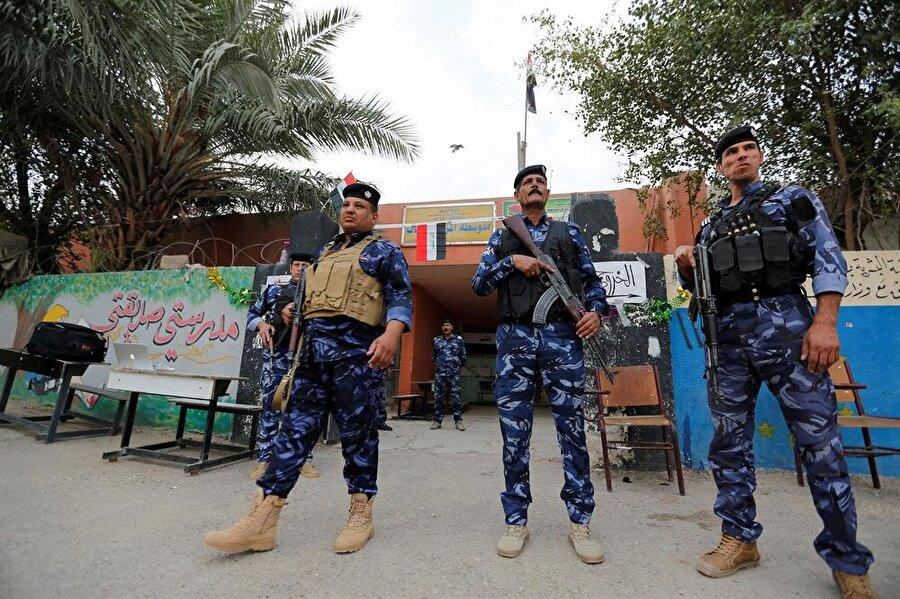 Seçimler, yoğun güvenlik önlemleri altında gerçekleştiriliyor. (Wissm al Okili / Reuters)