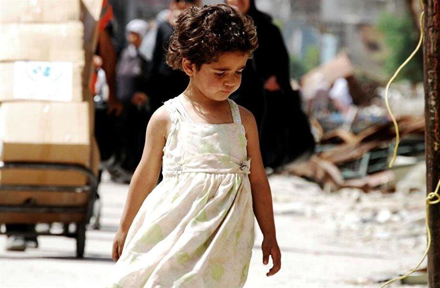 Doğuştan mülteci olan Yermüklü çocuklar, Esed güçlerinin kuşatması altında büyüyorlardı. (Fotoğraf: Niraz Said)