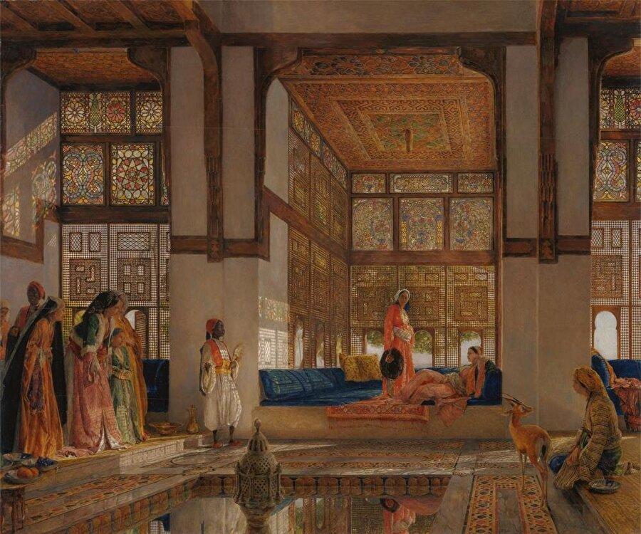 """John Frederick Lewis'in bir harem manzarasını resmettiği """"Hanıma ziyaretçi geliyor."""" adlı tablosu."""