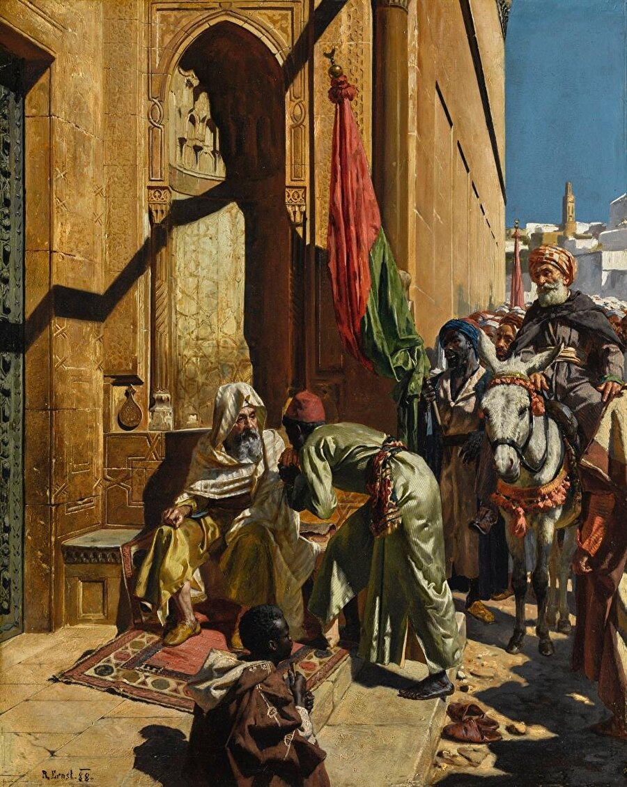 """Rudolf Ernst'in sokak manzaralarını resmettiği eserlerinden biri olan """"Müneccim"""" tablosu."""