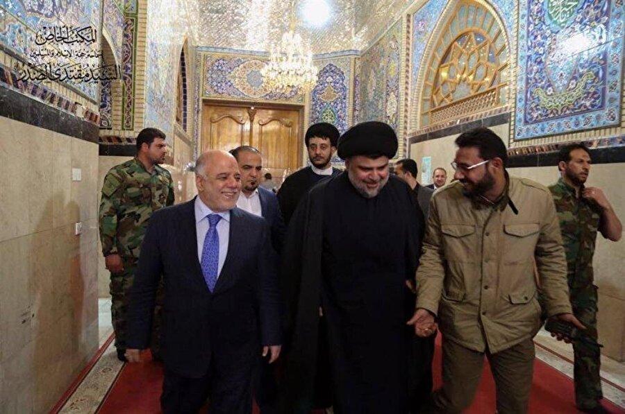 Irak Başbakanı Haydar Abadî (solda), iktidardaki son dönemini yaşıyor.