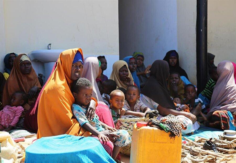 Bölge sakinleri bir yandan terör korkusunu bir yandan da yakın zamanda meydana gelen selin yıkıcı etkisini yaşıyor. (Sadak Mohamed / AA)