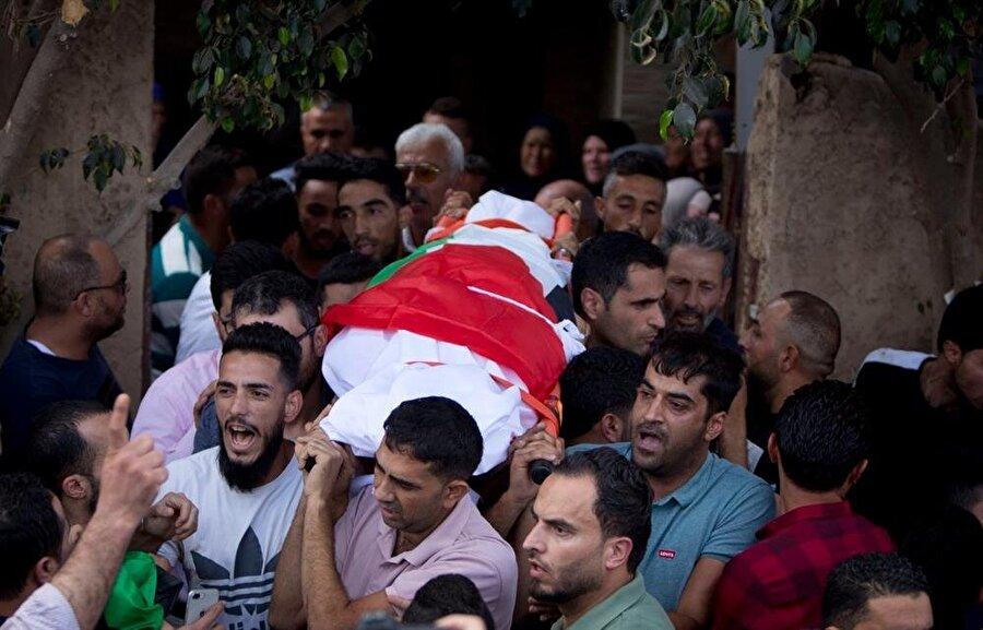 Âişe Muhammed Rabi'nin cenazesinde İsrail işgaline büyük öfke vardı.