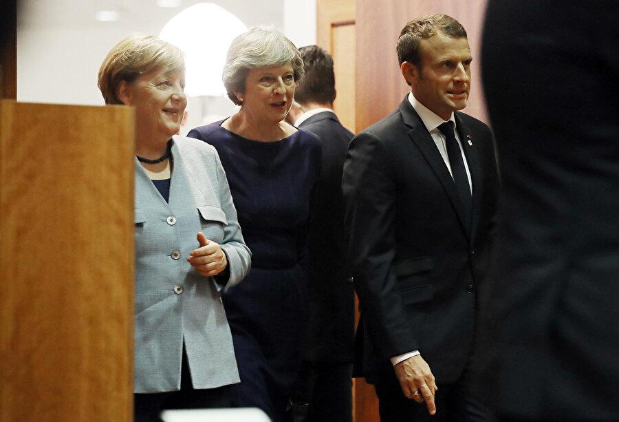 İngiltere Başbakanı Theresa May, Fransa Cumhurbaşkanı Emmanuel Macron ve Almanya Başbakanı Angela Merkel