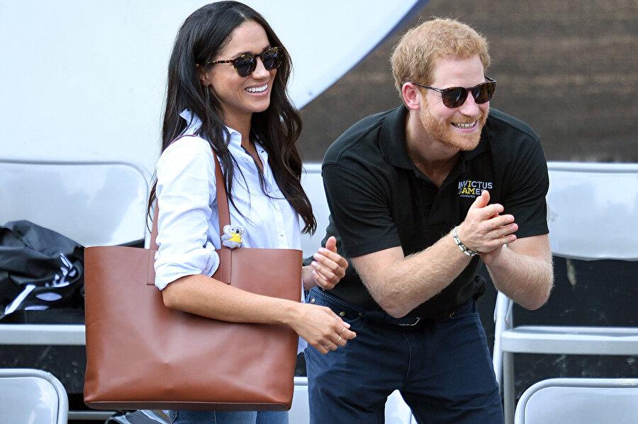 Meghan Markle ve Prens Harry'nin evlenmeden önce katıldıkları bir etkinlikten kareleri.
