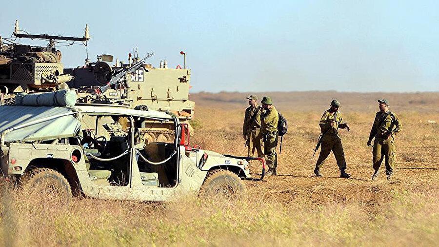 İsrail ordusunun, işgal ettiği Golan Tepeleri ve Ürdün Vadisi'nde yaptığı tatbikatan bir görüntü.