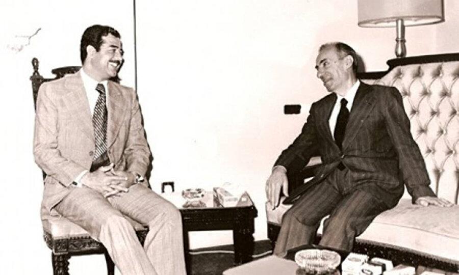 Mişel Aflak'ı himayesine alan Saddam Hüseyin (solda), Aflak'ın gizlice İslâm'ı seçtiğini de iddia etmişti.