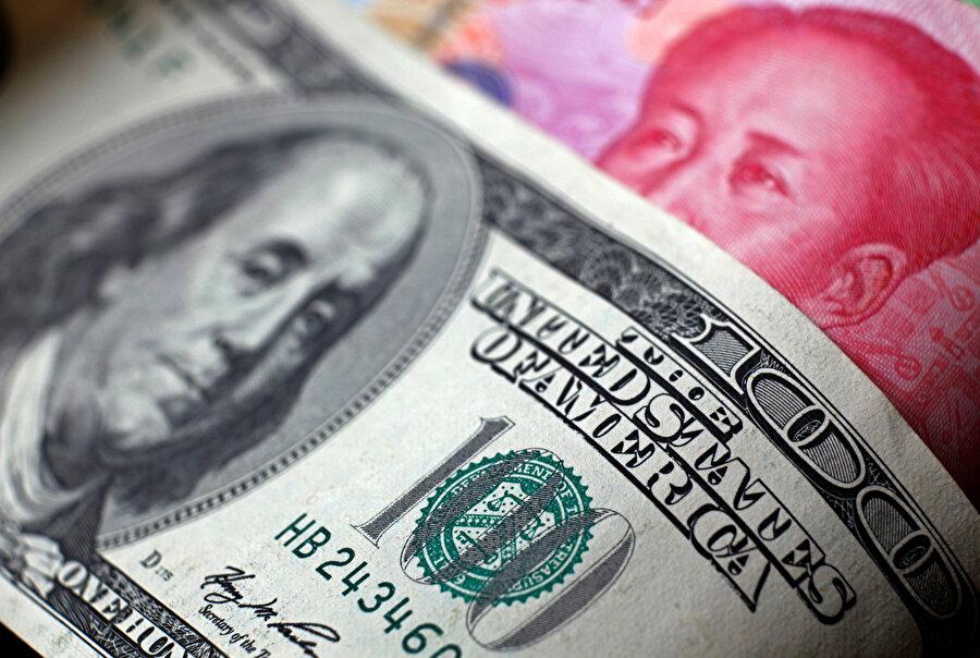 Yuan, sene başından bu yana dolar karşısında yüzde 2,23 değer kaybetti.