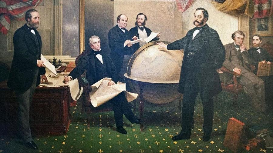 ABD Dışişleri Bakanı William Seward (oturmuş) Rusya'nın ABD Büyükelçisi Baron Edouard de Stoeckl (sağda duruyor) ile 1867'de Washington DC'de Alaska Satın Alma Anlaşması imzaladı.