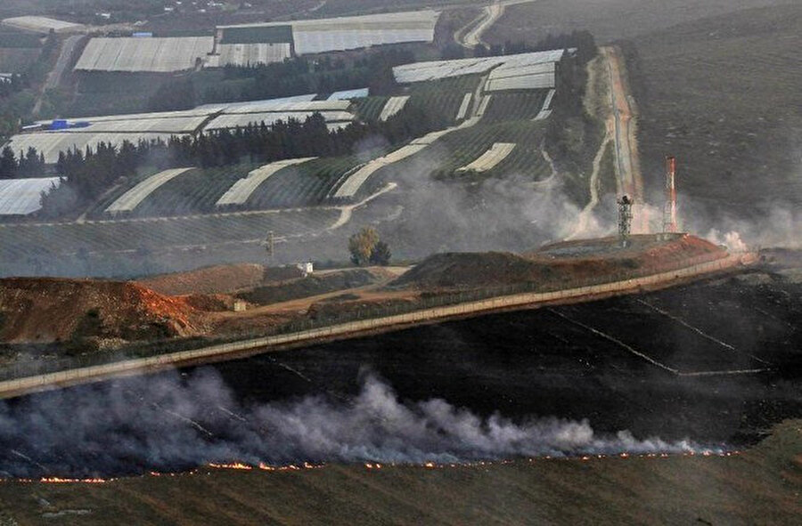 İsrail güçleri ile Hizbullah savaşçılarının karşılıklı ateşi sonrası Lübnan'ın İsrail sınırı boyunca dumanlar yükseldiği görülüyor. (1 Eylül, 2019.)