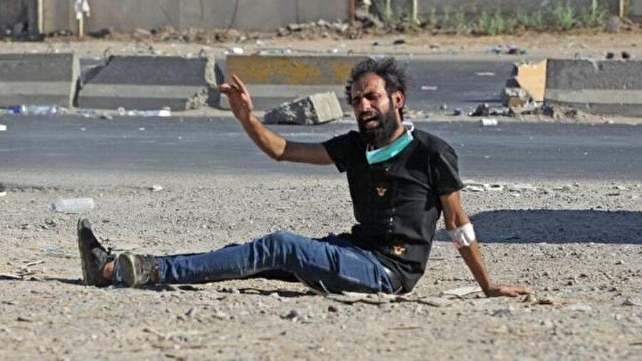 Gösteriler sırasında protestocunun vurulma anına şahit olan bölgedeki Reuters muhabirlerinin objektifinden.