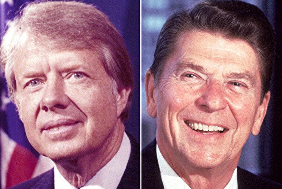 ABD Başkanı Jimmy Carter (solda), rehine krizinin birinci yılında düzenlenen başkanlık seçimlerini Cumhuriyetçi rakibi Ronald Reagan'a karşı kaybetti.
