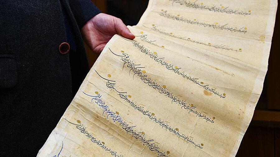 Belgede 1566 tarihli belgede, Kanuni Sultan Süleyman'ın bazı kişilere toprak tahsisi yönündeki talimatları bulunuyor.