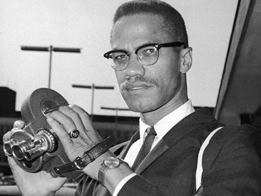 Malcolm X, film kamerasıyla Londra'da 1964.