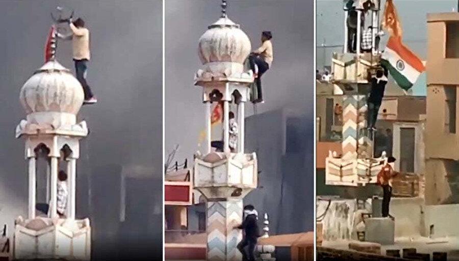 Minarenin üzerine çıkan kişi, eliyle hilali yerinden sökmeye çalışırken çevresindekiler de ona destek oldu.