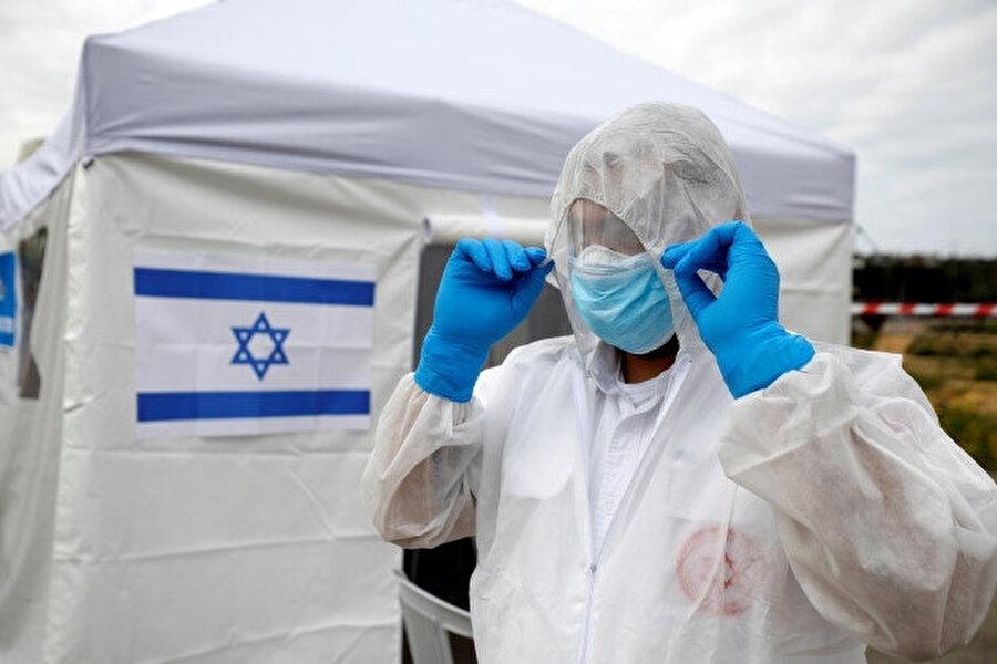Koronavirüs salgını, İsrail'i de ciddi biçimde etkilemeyi sürdürüyor.