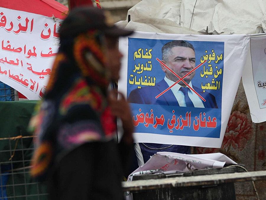 Ekim ayından beri protestolara devam eden göstericiler Adnan ez-Zurfi'nin adaylığına sıcak bakmıyor.
