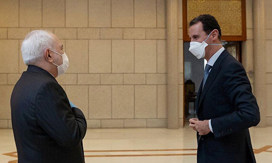 Esed'in, 20 Nisan 2020'de İran Dışişleri Bakanı Zarif'le Şam'daki görüşmesi.