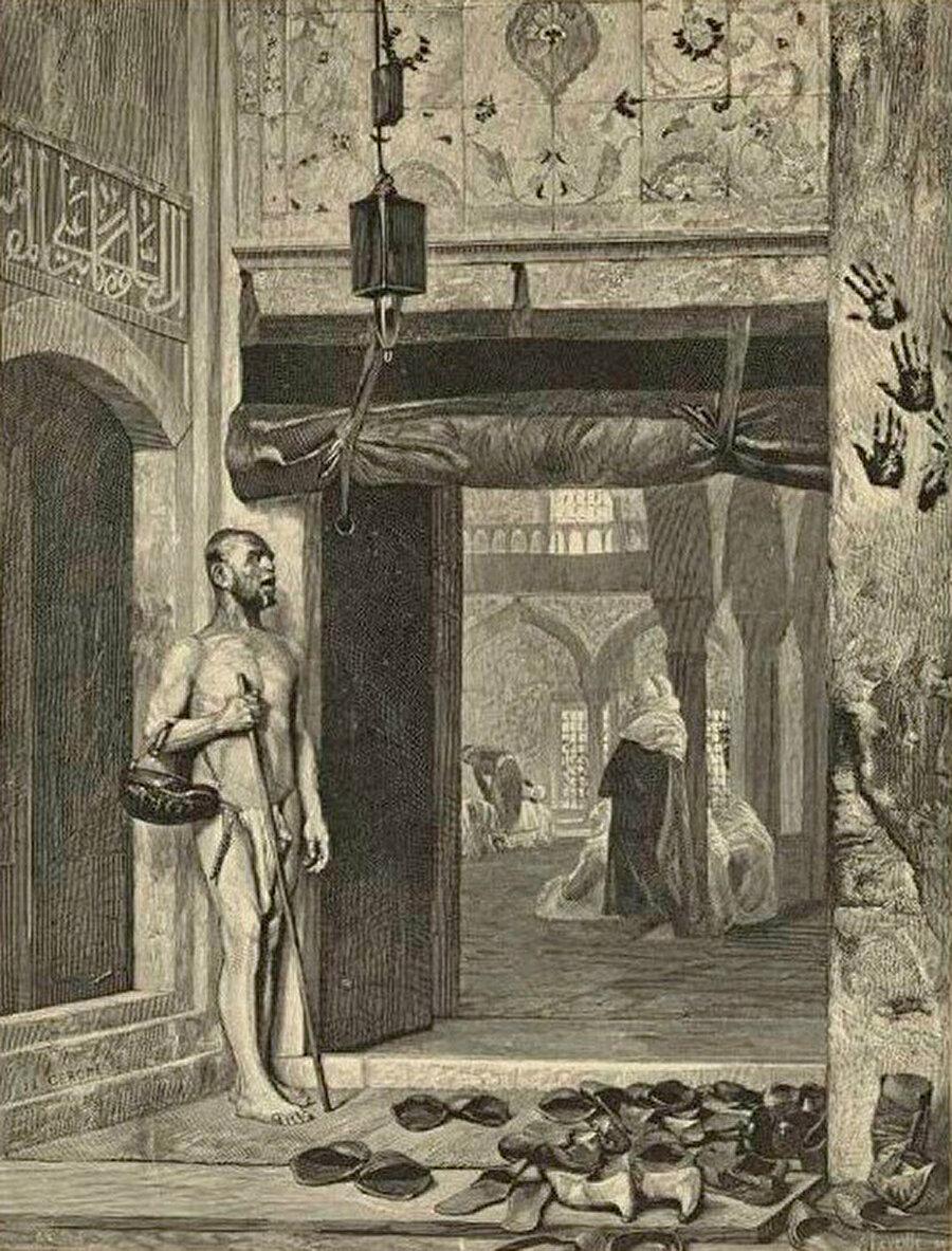 Caminin kapısında bekleyen Mağribi Kalenderî dervişi. (1881, Gérôme, Jean Léon, NYPL Dijital koleksiyonu )