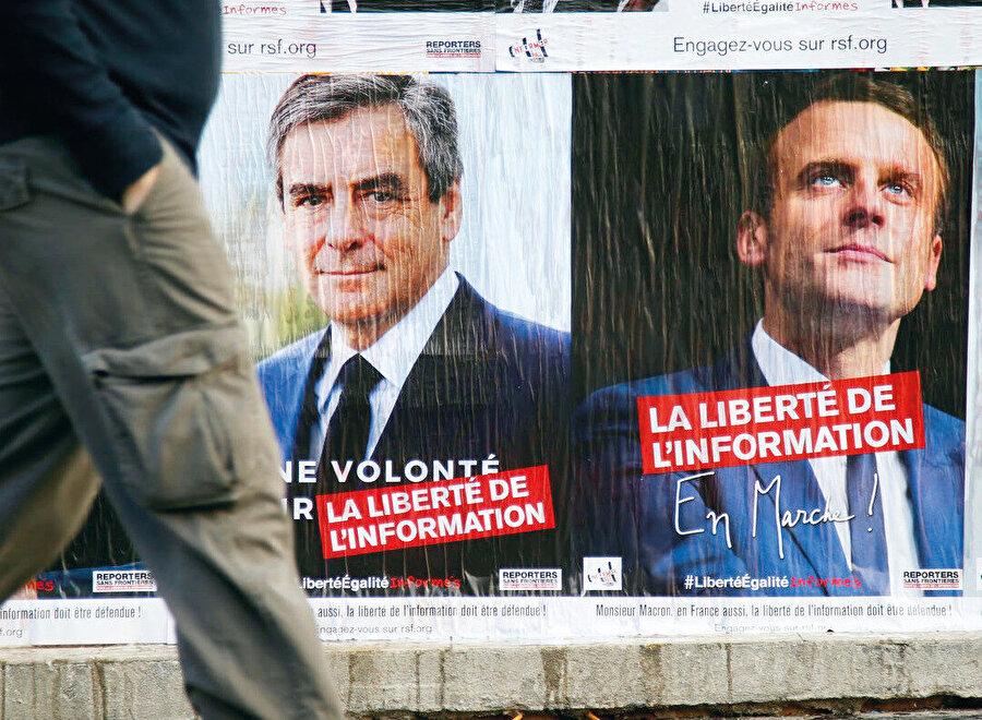 Fillon ve Macron seçim afişleri