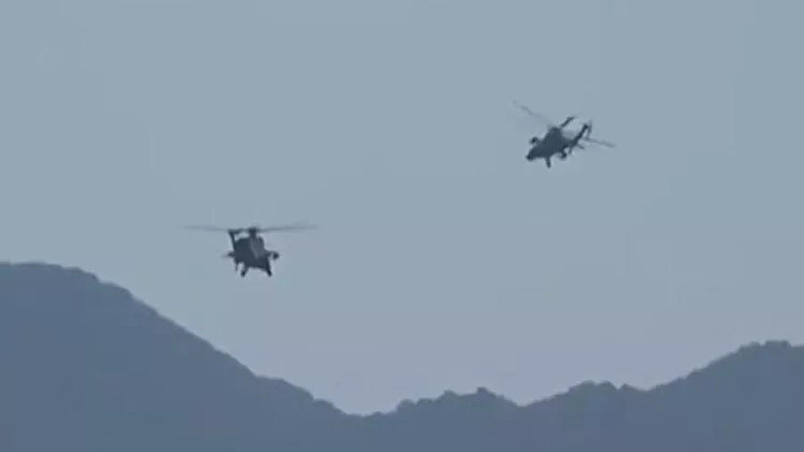 Helikopterler bölgenin üzerinde uçuyor